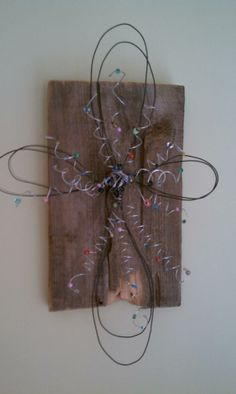 WIre & Bead Cross attached to an old piece of wood.