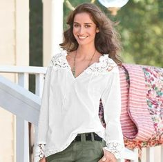 """Rustic refinement in pristine cotton, lavished with Venice lace at the ruffled tie-neck, sleeves and hem. Pintucks march the length of the sleeves. Hand wash. Imported. Exclusive. Sizes XS (2), S (4 to 6), M, (8 to 10), L (12 to 14), XL (16). Approx. 27""""L."""