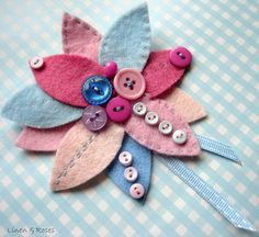 Pink and blue felt flower corsage with button decoration and ribbon trim by Linen & Roses
