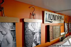 From Life as a Thrifter, a creative laundry room art display. See more great ideas at http://decoratingfiles.com/2012/06/creative-diy-and-nifty-storage-solutions/