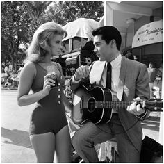 Ann-Margret and Elvis Presley rehearse the duet they are to sing in the film Viva Las Vegas. 1963