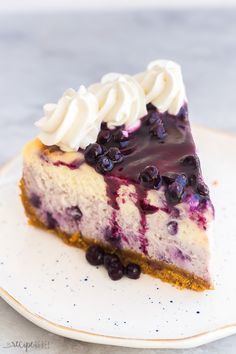 Perfect Blueberry Cheesecake - made easier! [VIDEO] - The Recipe Rebel This Blueberry Cheesecake is ultra creamy and swirled with fresh blueberry sauce. It's baked to perfection with no water bath and no fuss! Easy Blueberry Cheesecake Recipe, Best Homemade Cheesecake Recipe, No Bake Lemon Cheesecake, Blueberry Desserts, Cheesecake Recipes, Dessert Recipes, Blueberry Sauce, Blueberry Chiffon Cake Recipe, Turtle Cheesecake