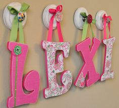 Custom wooden hanging nursery letters baby name sign nursery wall letter art girl nursery decor- to match any bedding, color, and theme. $15.75, via Etsy.