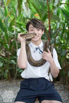 Jungkook holding a snake and iam looking at him .