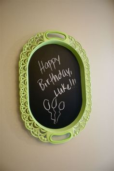 Just spray paint an old tray with chalkboard paint just like this!