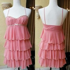 SALE Pink ruffle dress Gorgeous brand new dress from Xtraordinary. Size small- mini dress with ruffles and designs around chest. Has some pilling around chest which is reflected in price xtraordinary Dresses Mini