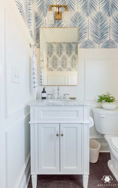 Powder Room Makeover Reveal Gorgeous coastal modern bathroom design and decor with mixed gold & silver metals. Loving the blue and white palm fronds wallpaper. Coastal Powder Room, Powder Room Decor, Powder Room Design, Small Powder Rooms, Home Interior, Bathroom Interior, Kitchen Interior, Modern Interior, Interior Design