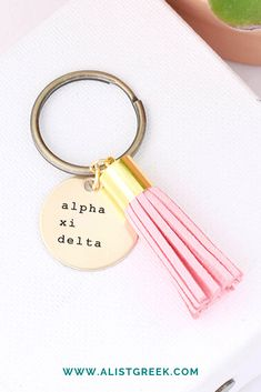 Alpha Xi Delta sorority tassel keychain comes in your choice of color for a suede leather tassel and is laser engraved. Shop now! Delta Sorority, Sorority Letters, Alpha Xi Delta, Gamma Phi Beta, Sorority Gifts, Bid Day Gifts, Leather Tassel Keychain, Sorority Big Little, Big Little Gifts