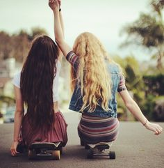 omg this picture totally describes us!!! hair, skateboard, and everything!!!!!