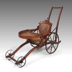 Victorian era convertible high chair buggy. Baby chair converts from high chair to buggy with the pull of lever.