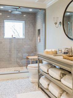 Stunning open shelving vanity! Don't miss the huge waterfall shower head with tile ceiling. #Inspiration #GreenBasementsAndRemodeling #bathroom #shower #Atlantaconstruction