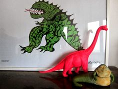 At home: neon dino vs. jabba the hut vs. Niki de Saint Phalle print.