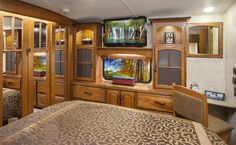 Nice cabinets built over the dresser in a fifth wheel master bedroom