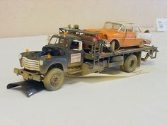 Fantastic weathering job!  The wrecker appears to be a major conversion while…
