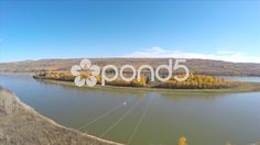 Aerial Shot Tracking Hover Over River Electric Pylons Field Trees Drone Footage - Stock Footage   by RyanJonesFilms #aerial #drone #quadcopter #river #town #village #houses #aerialshot #gopro #phantom #sun #water #town #travel #horizon #neighborhood #hills #forest #field #woods #trees #powerlines