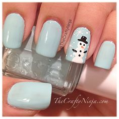 The Crafty Ninja designed these pretty snowman nails