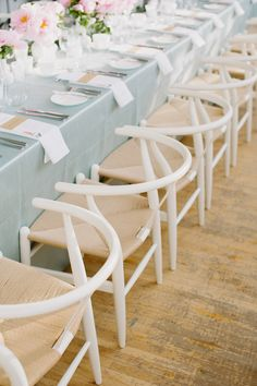 Dusty blue linens with white woven chairs