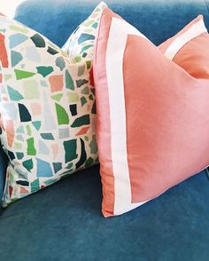 Pillows by designer Dominique DeLaney of Comfy Cozy Couture featuring fabrics by Duralee (left) and Robert Allen (right) with trim by Samuel and Sons.