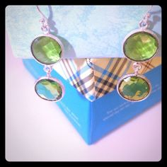 Peridot Dangly Earrings Gorgeous Green Peridot Earrings. Lovely circles!   These are truly beautiful. Handcrafted sterling silver. NEW. Pls visit my closet and FB page (Sassygalshops)!  I have tons of fab items. And in constantly adding to the bay's collection. I take pride in the items I find. I only sell items I personally would wear which makes selling them, sometimes hard!!  Hope u love it all!!  💋💋 Sassy Gal handcrafted Jewelry Earrings