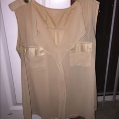 Tan sleeveless blouse Perfect work attire or casual wear. Great everyday top Tops Blouses