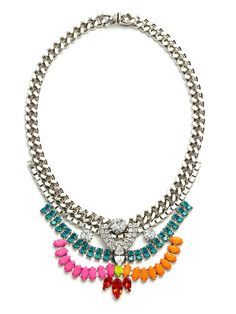 This grand statement necklace pulls its inspiration from Grace Kelly, the princess years. It's regal and oh-so-extravagant, but features chain links and a palette of fun colors—sparkling blues, fuchsias and tangerines—so it's plenty street-chic, too.  This is part of the Designer Pop-Up: Courtney Lee Collection