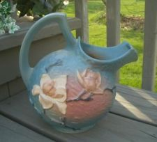 .  Orignial 1943.  ROSEVILLE POTTERY MAGNOLIA 1327 BLUE PINK LARGE PITCHER.  Asking $500 on ebay 1/2014