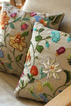 This crewel embroidery pillow is so pretty! I can imagine it stitched over a text fabric.