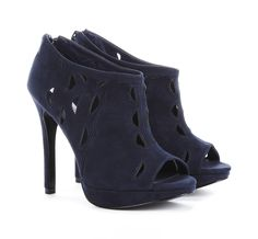 """Fashionista Editors Pick Our Favorite Sole Society Boots: Hayley's Pick: The Liana - """"These would look amazing with a short, full skirt, or a pretty evening dress. I'm into black-and-navy as a color combo so in the winter I'd definitely wear these with black tights!"""" ($49.95)"""