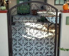This front entry gate is created with our small rosette.  Measure the size of your gate opening.  Lay a frame out on the ground, then fill in until you have the desired pattern.  #Indital our Wrought Iron supplier has thousands of pre-made design pieces to choose from.