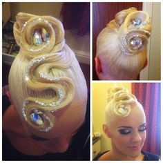High swirl bun with large front swoop and rhinestone accents. Great for standard ballroom, but can also be worn or latin. Visit http://ballroomguide.com/comp/hair_make_up.html for more hair and makeup info