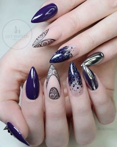Love the middle nail's designs