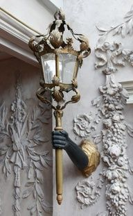 This kind of lamp was in the silent movie version of Beauty and the Beast, a hallway lined with them.