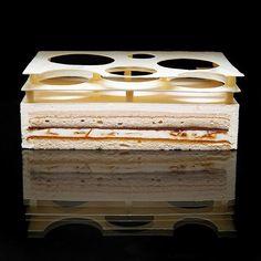 "Cake ""Catalane"" | Lady finger sponge cake, orange syrup, orange marmalade, caramel flakes, orange creme brûlée, cinnamon and orange bavarian cream, chocolate ganache"