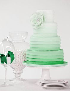 Green Ombre Wedding Cake - Maybe Maroon to Orange? Or Maroon or Orange with opposite color as accent piece like the flower?