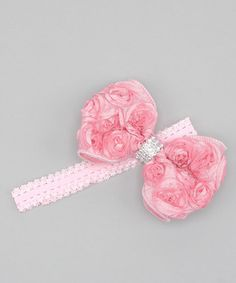 I could make this with rosette fabric and large spacer bead as center