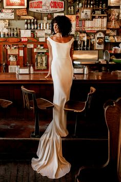 Hunter makes a statement, no matter what room she walks into. Sleek, sexy, and slightly off the shoulder, the stretch crepe column is classic, curve-hugging silhouette. Fishtail train and buttons down the back make for a glamorous exit.