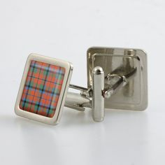 Pair of tartan cufflinks in metallic finish presentation box. These products use a resin doming...