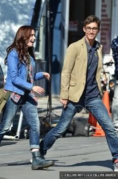 Lilly Collins and Robert Sheehan on set as Clary and Simon