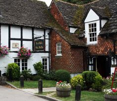 Ye Olde Six Bells in Horley, Surrey, England; reputedly the second oldest pub in the country with origins dating to the 9th century. The pub's name derives from the original bells which hung at St. Bartholomew's church next door.