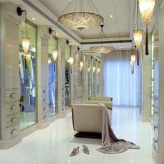 Amazing walk-in closet with a beautiful ambient lighting and surrounded mirrors | Bedroom decor ideas | Bedroom design| Luxury bedroom | Contemporary Bedroom | For more inspirational ideas take a look at: www.homedecorideas.eu