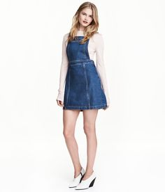 Check this out! CONSCIOUS. Knee-length bib overall dress in washed denim. Adjustable suspenders, large bib pocket, buttons at sides, and a concealed side zip. Cotton content is partly recycled. - Visit hm.com to see more.