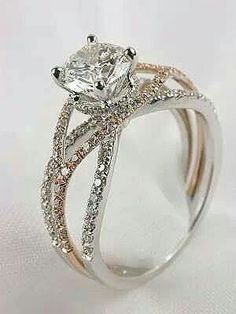 This is the wedding band I want but without all the extra diamonds. Two people brought together by the grace of God. The perfect relationship, two people who love each other and a Heavenly Father who bonds them. ♡