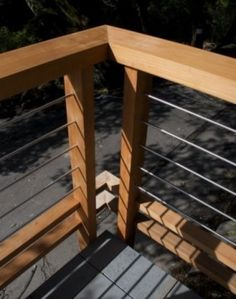 Deck railing with strong horizontal wood element