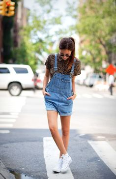 In this picture this girl is wearing short overalls as a street style. The overalls were created in 1602, then became popular in the 90s and now it is a current style. -Ashlie 2/8