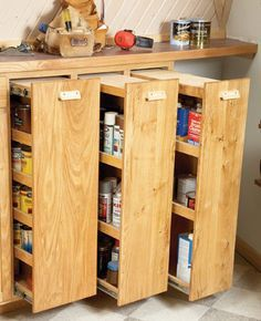 DIY: Workshop Rollouts - here's an awesome way to organize your garage! This tutorial shows how to make these space-saving shelves. Would be awesome in craft room! Kitchen Cabinet Storage, Storage Cabinets, Kitchen Pantry, Diy Kitchen, Kitchen Cabinets, Kitchen Ideas, Kitchen Small, Diy Cabinets, Kitchen Decor