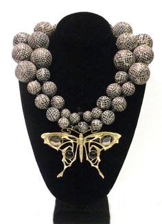 Snakeskin Print Leather Orbs, Leather Braid, Art Nouveau Butterfly: $875.00Antique Studded Orb: $535.00