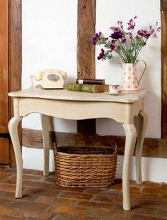 A simple step-by-step guide from Helaine Clare shares how to transform a plain console table into an elegant piece, with a beautiful French Country look