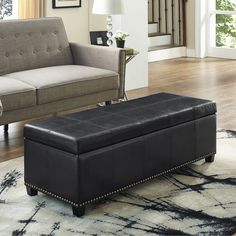 Simpli Home Kingsley Leather Storage Ottoman Bench - Decorative top stitching, nail head trim, and premium bonded leather color options make the Simpli Home Kingsley Leather Storage Ottoman Bench...
