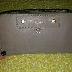 Marc by Marc Jacobs wallet Tan Marc by Marc Jacobs wallet. 12 credit card slots. Good condition. Has a subtle water line stain, shown in 2nd photo. Marc by Marc Jacobs Bags Wallets