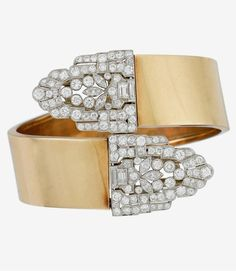 An Art Deco diamond, platinum and fourteen karat gold clip bangle bracelet, Raymond Yard wide polished gold by-pass motif hinged bangle with removable Art Deco clips set with single, transitional, baguette and marquise-cut diamonds; total diamond weight approximately: 8.50 carats; signed Yard. #RaymondYard #ArtDeco #bangle #bracelet